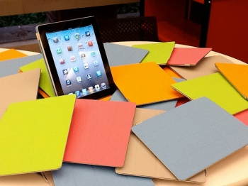 Image of iPad surrounded by folders
